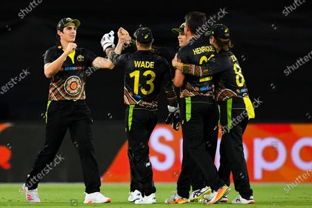 Sean Abbott of Australia (L) celebrates after claiming the wicket of KL Rahul of India during the first T20 cricket match between Australia and India at Manuka Oval in Canberra, Australia, 04 December 2020.