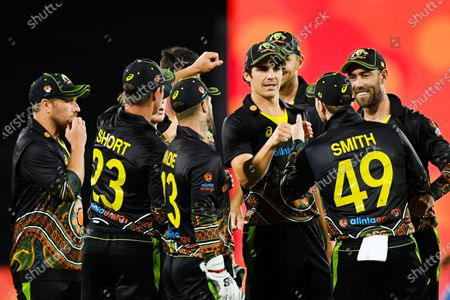 Sean Abbott of Australia (C-R) celebrates with team mates the wicket of Hardik Pandya of India during the first T20 cricket match between Australia and India at Manuka Oval in Canberra, Australia, 04 December 2020.
