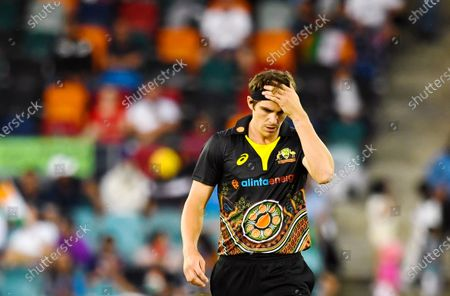 Sean Abbott of Australia reacts during the first T20 cricket match between Australia and India at Manuka Oval in Canberra, Australia, 04 December 2020.