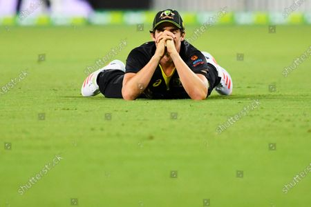 Sean Abbott of Australia reacts after failing to catch a ball during the first T20 cricket match between Australia and India at Manuka Oval in Canberra, Australia, 04 December 2020.