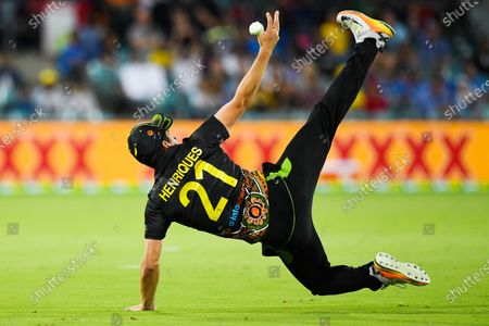 Moises Henriques of Australia fails to catch a ball during the first T20 cricket match between Australia and India at Manuka Oval in Canberra, Australia, 04 December 2020.