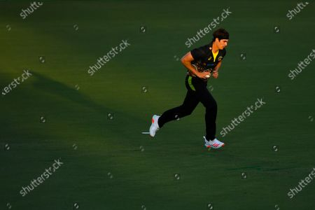 Sean Abbott of Australia in action during the first T20 cricket match between Australia and India at Manuka Oval in Canberra, Australia, 04 December 2020.