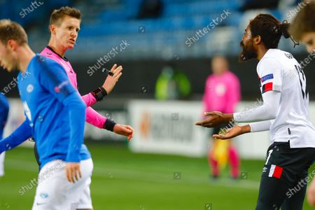 Dundalk's Nathan Oduwa (R) talks to referee Daniel Siebert during the UEFA Europa League group B soccer match between Molde and Dundalk at Aker Stadium, Molde, Norway, 03 December 2020.