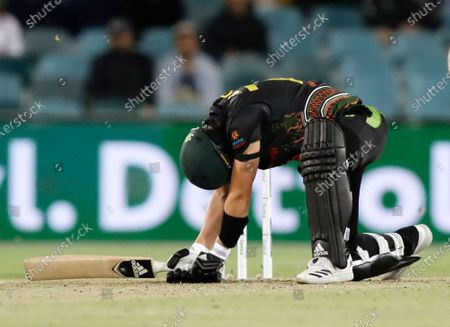 Australia's Sean Abbott reacts while batting during the T20 international cricket match between India and Australia at Manuka Oval, Canberra, Australia