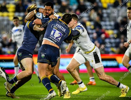 Stock Image of Francois Venter and Oli Morris of Worcester Warriors attempt to tackle Joe Cokanasiga of Bath Rugby during the Gallagher Premiership match between Worcester Warriors and Bath Rugby, 05 December 2020.