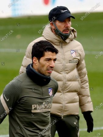 Stock Picture of Atletico Madrid's Uruguayan striker Luis Suarez (L) and his coach Diego Simeone (R) attend their team's training session at Sports City in Majadahonda, Madrid, Spain, 04 December 2020. Atletico Madrid will face Real Valladolid in their Spanish La Liga soccer match on 05 December 2020.