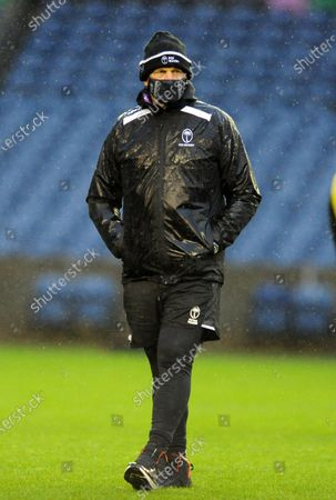 Stock Image of Vern Cotter - Fiji head coach is soaking wet during a torrential downpour at the captain's run in Edinburgh.