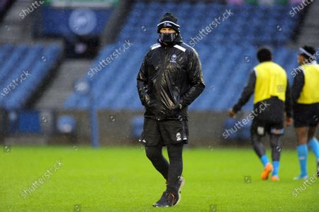 Vern Cotter - Fiji head coach is soaking wet during a torrential downpour at the captain's run in Edinburgh.