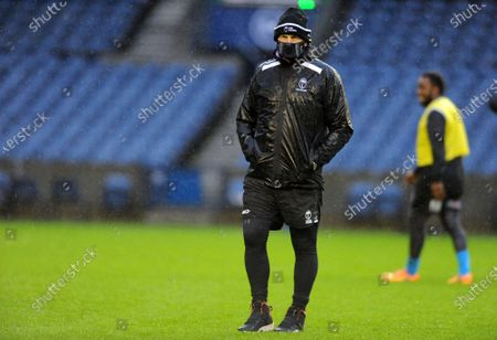 Stock Picture of Vern Cotter - Fiji head coach is soaking wet during a torrential downpour at the captain's run in Edinburgh.