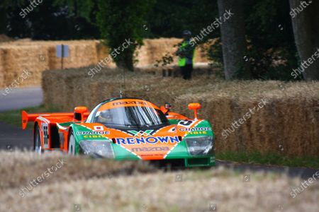 Goodwood Estate, West Sussex. 30th June - 3rd July 2011 The 1991 Le Mans winning Mazda 787B climbs the hill. Action. World Copyright: Lord Hutton/LAT Photographic