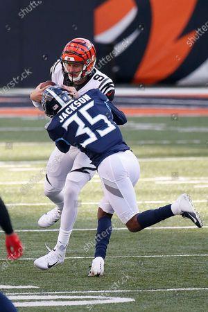 Cincinnati Bengals quarterback Joe Burrow #9 is hit by Tennessee Titans defensive back Chris Jackson #35 during an NFL football game between the Tennessee Titans and the Cincinnati Bengals, in Cincinnati