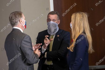 Georgia Congressman Doug Collins (center) speaks with Georgia Senators Kelly Loeffler (right) and David Perdue (left) before the start of a round table discussion with Vice President Mike Pence and Dr. Robert Redfield, Director of the Centers for Disease Control and Prevention, at the Center for Disease Control and Prevention in Atlanta, Georgia, USA, 04 December 2020.