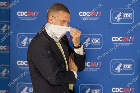 Georgia Congressman Doug Collins adjusts his face mask before the start of a round table discussion with Vice President Mike Pence and Dr. Robert Redfield, Director of the Centers for Disease Control and Prevention, at the Center for Disease Control and Prevention in Atlanta, Georgia, USA, 04 December 2020.