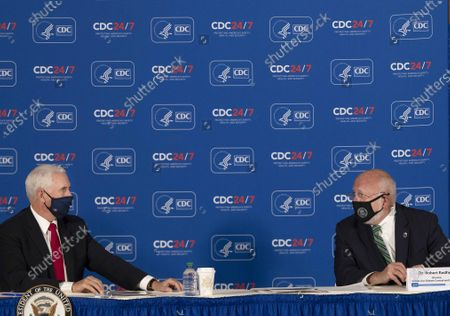 US Vice President Mike Pence (left) and Dr. Robert Redfield (right), Director of the Centers for Disease Control and Prevention, speak to each other during a round table discussion with other CDC staff at the Center for Disease Control and Prevention in Atlanta, Georgia, USA, 04 December 2020.