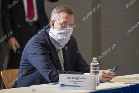 Georgia Congressman Doug Collins waits to participate start of a round table discussion with Vice President Mike Pence and Dr. Robert Redfield, Director of the Centers for Disease Control and Prevention, at the Center for Disease Control and Prevention in Atlanta, Georgia, USA, 04 December 2020.