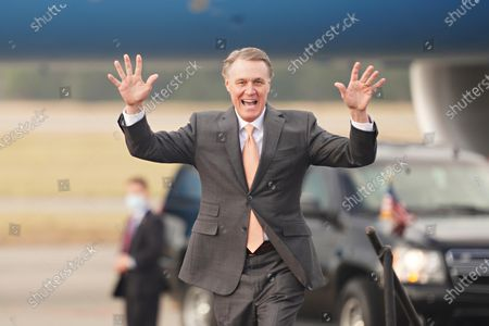 Georgia Republican Senator David Perdue takes the stage for a campaign rally in the runoff election at Savannah/Hilton Head International Airport in Savannah, Georgia, USA, 04 December 2020. Perdue faces Democrat John Ossoff and Loeffler faces Reverend Rafael Warnock in the 05 January 2021 runoff election.