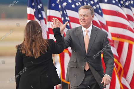 Georgia Republican Senator David Perdue is greeted by Republican National Chairwoman Ronna McDaniel as he takes the stage for a campaign rally in the runoff election at Savannah/Hilton Head International Airport in Savannah, Georgia, USA, 04 December 2020. Perdue faces Democrat John Ossoff and Loeffler faces Reverend Rafael Warnock in the 05 January 2021 runoff election.