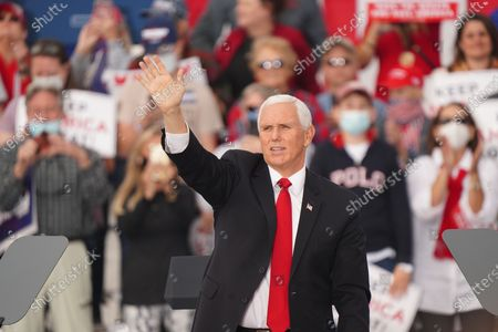 Stock Image of US Vice President Mike Pence participates in a campaign rally to support the runoff election of Georgia Republican Senators David Perdue and Kelly Loeffler at Savannah/Hilton Head International Airport in Savannah, Georgia, USA, 04 December 2020. Perdue faces Democrat John Ossoff and Loeffler faces Reverend Rafael Warnock in the 05 January 2021 runoff election.