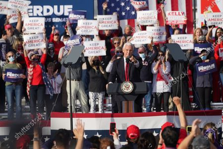 Stock Picture of US Vice President Mike Pence participates in a campaign rally to support the runoff election of Georgia Republican Senators David Perdue and Kelly Loeffler at Savannah/Hilton Head International Airport in Savannah, Georgia, USA, 04 December 2020. Perdue faces Democrat John Ossoff and Loeffler faces Reverend Rafael Warnock in the 05 January 2021 runoff election.