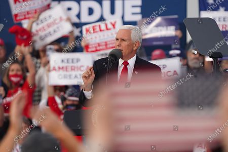 US Vice President Mike Pence participates in a campaign rally to support the runoff election of Georgia Republican Senators David Perdue and Kelly Loeffler at Savannah/Hilton Head International Airport in Savannah, Georgia, USA, 04 December 2020. Perdue faces Democrat John Ossoff and Loeffler faces Reverend Rafael Warnock in the 05 January 2021 runoff election.