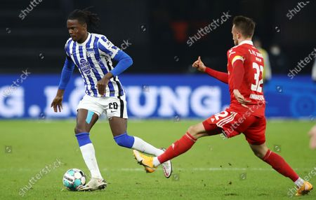 Dedryck Boyata (L) of Hertha is challenged by Marcus Ingvartsen of Union during the German Bundesliga soccer match between Hertha BSC and 1. FC Union Berlin at Olympiastadion in Berlin, Germany, 04 December 2020.