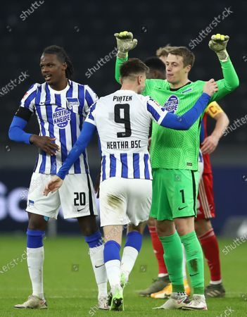 Dedryck Boyata, Krzysztof Piatek and goalkeeper Alexander Schwolow (L-R) of Hertha celebrate after the German Bundesliga soccer match between Hertha BSC and 1. FC Union Berlin at Olympiastadion in Berlin, Germany, 04 December 2020.