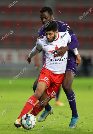 Stock Picture of Anderlecht's Mustapha Bundu and Essevee's Bassem Srarfi fight for the ball during a soccer match between Zulte Waregem and RSC Anderlecht, Friday 04 December 2020 in Waregem, on the fifteenth day of the 'Jupiler Pro League' first division of the Belgian championship.