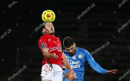 Duje Caleta-Car (R) of Olympique Marseille and Renaud Ripart of Nimes  Olympique in action during the French Ligue 1 soccer match between Nimes Olympique and Olympique Marseille, in Nimes, France, 04 December 2020.