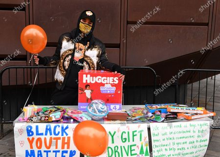 Activist/Fashion Designer Jason Christopher Peters poses for a photo at a toy/gift drive he organized outside of The Barclays Center in Brooklyn, New York City.
