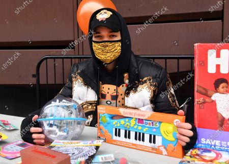 Stock Picture of Activist/Fashion Designer Jason Christopher Peters poses for a photo at a toy/gift drive he organized outside of The Barclays Center in Brooklyn, New York City.