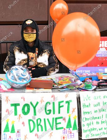 Stock Photo of Activist/Fashion Designer Jason Christopher Peters poses for a photo at a toy/gift drive he organized outside of The Barclays Center in Brooklyn, New York City.
