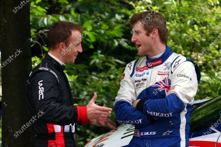 Goodwood Estate, West Sussex. 30th June - 3rd July 2011 Mini WRC driver Kris Meeke talks with Peugeot's IRC driver Guy Wilks. Portrait. World Copyright: Lord Hutton/LAT Photographic