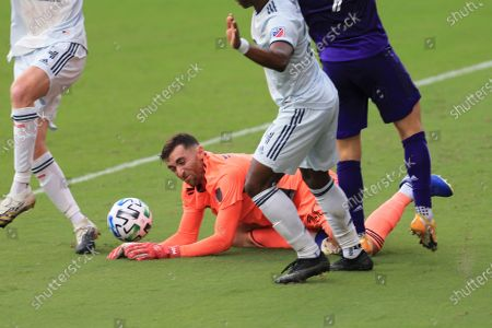 New England Revolution goalkeeper Matt Turner (30) makes a save against Orlando City during the first half of an MLS playoff soccer match, in Orlando, Fla