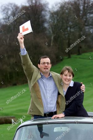 Peter Mallett (37) And His Partner Julie Costello (27) Who Won A11.7 Million On The National Lottery Pictured With An Aston Martin Db6 At Moor Park Golf Club.