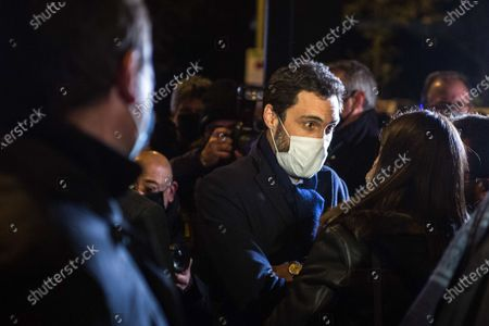The president of the Parliament of Catalonia, Roger Torrent wearing a face mask stands with a group of Catalan independence activists.