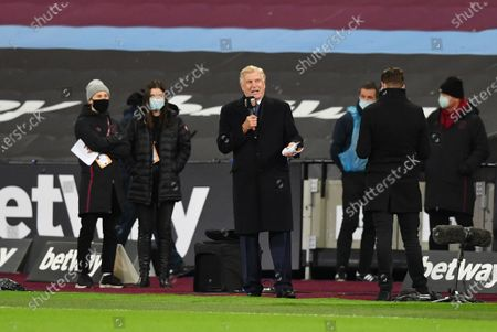 Sir Trevor Brooking talks before the first match back at the London Stadium with West Ham fans in attendance