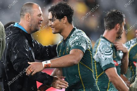 Stock Image of Former Wallabies coach Michael Cheika, working as a consultant for the Puma's, embraces Jordan Petaia of the Wallabies of the Wallabies during the Tri Nations rugby match between Argentina's Pumas and Australia's Wallabies at Bankwest Stadium, Sydney, Australia, 05 December 2020.