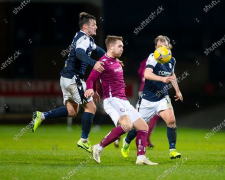 Scott Stewart of Arbroath challenges for the ball with Danny Mullen of Dundee; Dens Park, Dundee, Scotland; Scottish Championship Football, Dundee FC versus Arbroath.