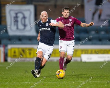 Charlie Adam of Dundee challenges for the ball with Dale Hilson of Arbroath; Dens Park, Dundee, Scotland; Scottish Championship Football, Dundee FC versus Arbroath.