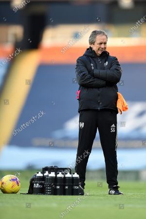 Stuart Gray of Fulham observes the team warming up.