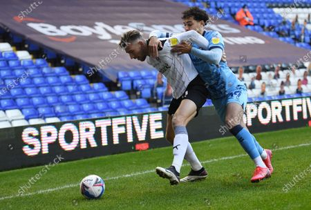 Stock Image of Angus MacDonald of Rotherham United and Tyler Walker of Coventry City