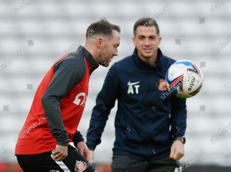 Stock Picture of Aiden McGeady of Sunderland returns to the starting line up against Wigan Athletic and is watched by Andrew Taylor caretaker manager of Sunderland as he warms up