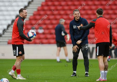 Stock Image of Chris Maguire of Sunderland (right) shares a joke with Andrew Taylor caretaker manager of Sunderland (centre) and Aiden McGeady of Sunderland