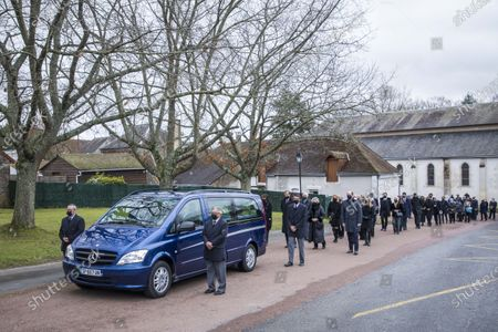 Stock Photo of Anne-Aymone Giscard d'Estaing (C), widow of the late former French president Valery Giscard d'Estaing, and sons Henri (CL) and Louis (CR) follow the hearse of Giscard d'Estaing's at the Saint Hilaire church in Authon, France, 05 December 2020. Giscard died on 02 December 2020 aged 94. The former French president Valery Giscard D'Estaing was head of state from 1974 to 1981.