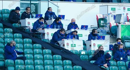 France's Head Coach Fabien Galthie looks on, top row 2nd left, along with defence coach Shaun Edwards, 2nd row 3rd right