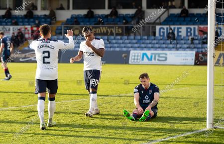 Callum Morris of Ross County on the ground after scoring an own goal, to make the score 3-0 to Rangers, as other goalscorer Alfredo Morelos and James Tavernier celebrate