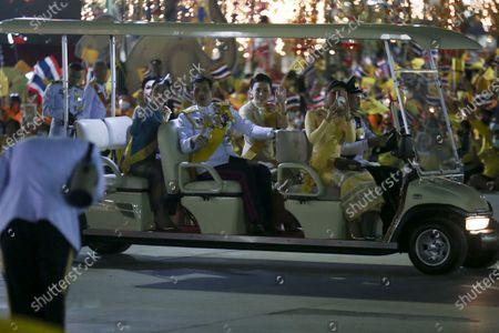 (L-R) Thai royal consort Sineenat Wongvajirapakdi, Thai Princess Bajrakitiyabha, Thai King Maha Vajiralongkorn Bodindradebayavarangkun, Thai Queen Suthida, and Thai Princess Sirivannavari Nariratana, ride in an electric car as they arrive for a ceremony in remembrance of late Thai King Bhumibol Adulyadej's birthday anniversary and also marking the National Father's Day, at Sanam Luang ceremonial ground in Bangkok, Thailand, 05 December 2020. King Bhumibol died at the age of 88 on 13 October 2016 after 70 years on the throne.
