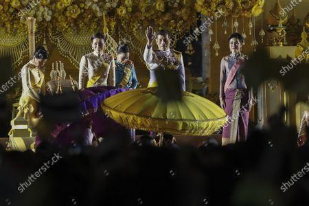 Stock Photo of (L-R) Thai Princess Sirivannavari Nariratana, Thai Queen Suthida, Thai Princess Bajrakitiyabha, Thai King Maha Vajiralongkorn Bodindradebayavarangkun, and Thai royal consort Sineenat Wongvajirapakdi, wave at well-wishers during a ceremony in remembrance of late Thai King Bhumibol Adulyadej's birthday anniversary and also marking the National Father's Day, at Sanam Luang ceremonial ground in Bangkok, Thailand, 05 December 2020. King Bhumibol died at the age of 88 on 13 October 2016 after 70 years on the throne.