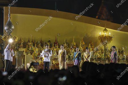 Stock Image of (L-R) Thai King Maha Vajiralongkorn Bodindradebayavarangkun, next to Thai Queen Suthida, Thai Princess Bajrakitiyabha, Thai Princess Sirivannavari Nariratana, and Thai royal consort Sineenat Wongvajirapakdi, preside over a ceremony in remembrance of late Thai King Bhumibol Adulyadej's birthday anniversary and also marking the National Father's Day, at Sanam Luang ceremonial ground in Bangkok, Thailand, 05 December 2020. King Bhumibol died at the age of 88 on 13 October 2016 after 70 years on the throne.