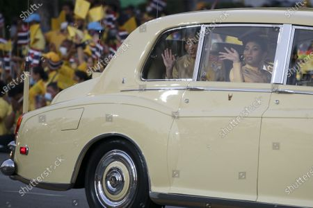 Thai Queen Suthida (L) and Thai Princess Sirivannavari Nariratana (R) wave at well-wishers as the Royal motorcade carrying the Thai Royal family arrives before the start of a ceremony in remembrance of late Thai King Bhumibol Adulyadej's birthday anniversary and also marking the National Father's Day, at Sanam Luang ceremonial ground in Bangkok, Thailand, 05 December 2020. King Bhumibol died at the age of 88 on 13 October 2016 after 70 years on the throne.